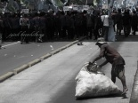a man picked up garbages dumped by protesters