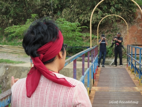 in action di Jembatan Talang Air
