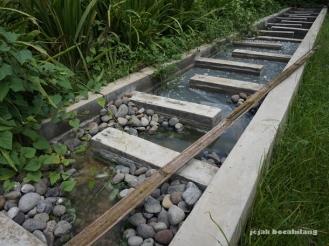 proses penyaringan limbah tahap akhir di Desa Kalisari